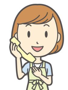 電話をする主婦